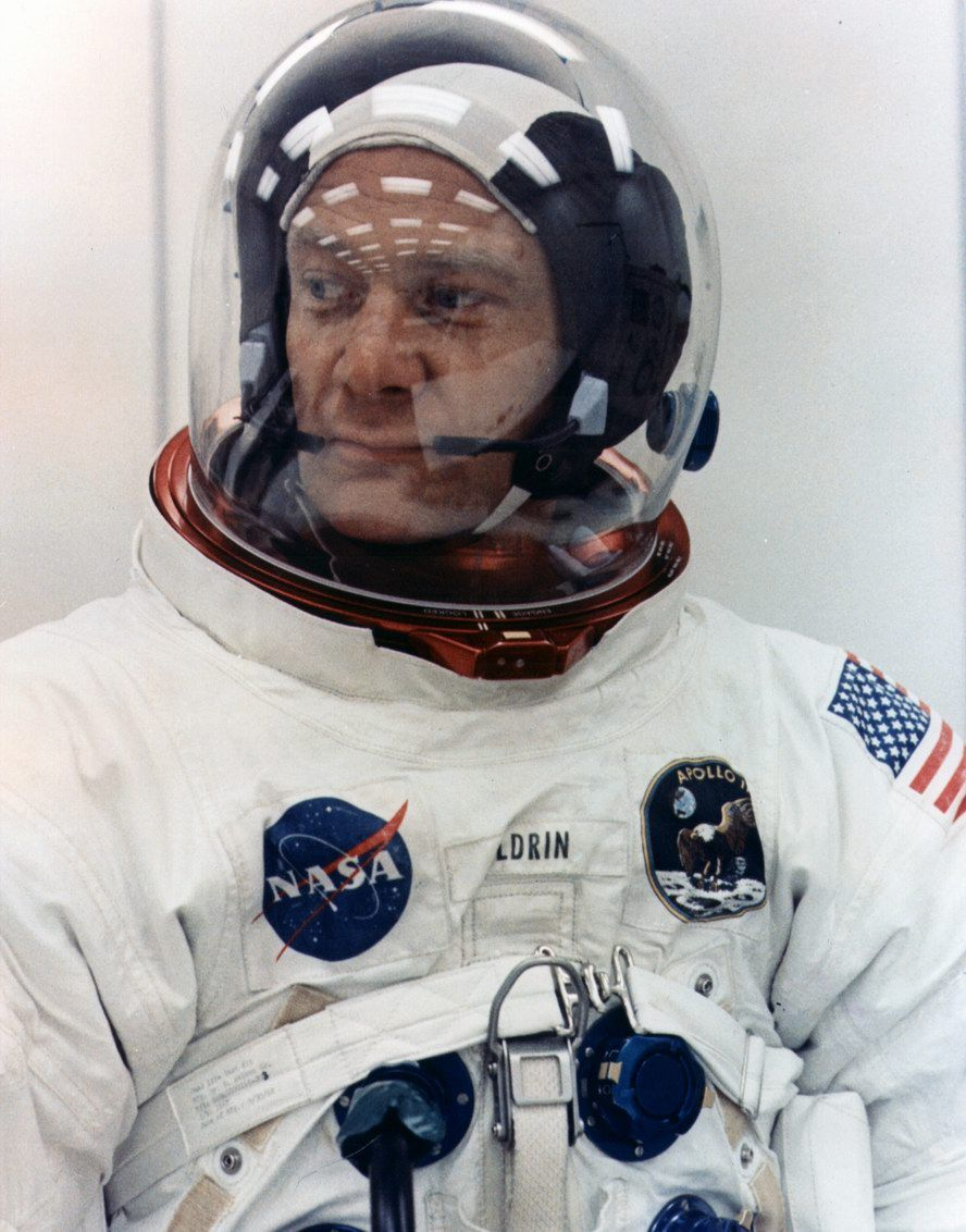 getting into his buzz aldrin space suit - photo #3