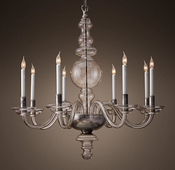 Crafted From A Mix Of Clear Glass And Tarnished Silver The Chandelier
