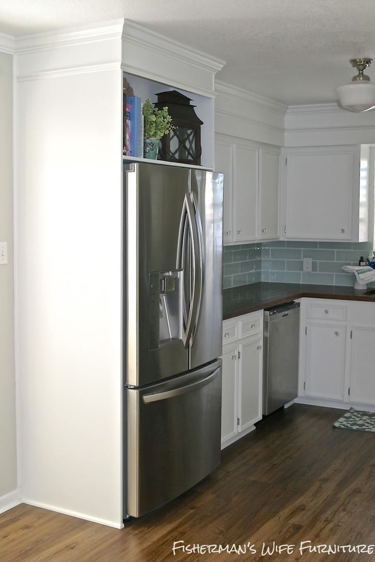 Built in refrigerator cabinet - Small White Kitchen Makeover With Built In Fridge Enclosure