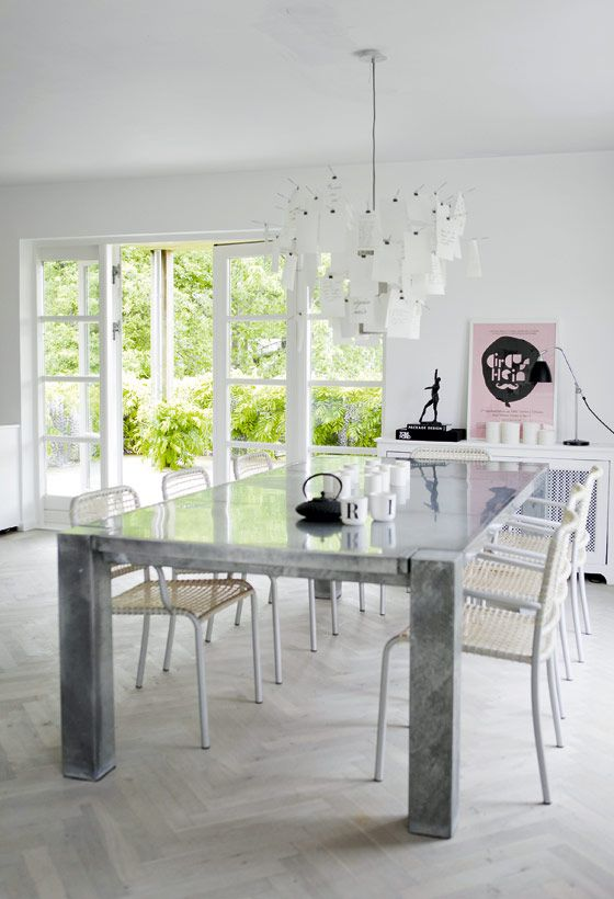 Custom made table, designed by the owner of the house and chairs by Paola Navone for Gervasoni.
