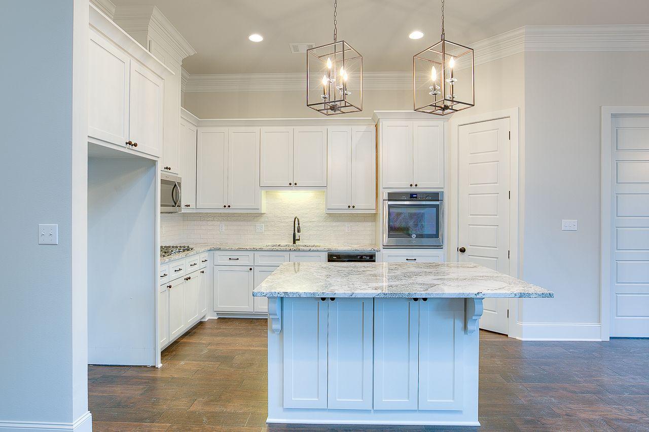 Stunning white kitchen with custom lighting! # ...