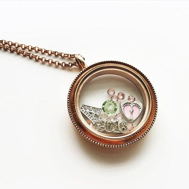 This rose gold locket is beautiful!  www.charmingsusie.origamiowl.com