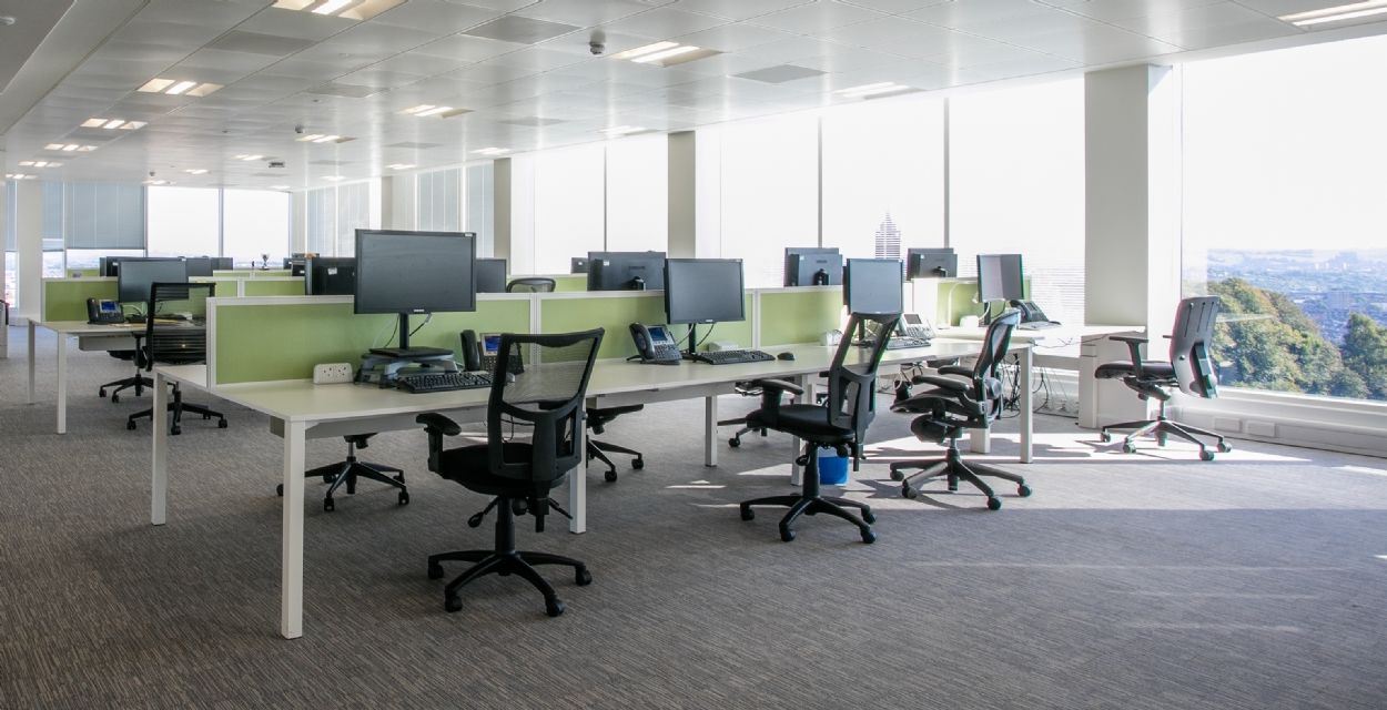 Open Plan Office Area Light And Airy Rows Of Desks And Computer