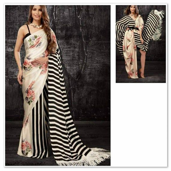 On Sale*LATEST SAREE COLLECTION*Best saree for night party 👗 SAREE FABRICS - Satin Georgette embroidery WORK👘 BLOUSE - BANGLORI ✤ STITCHING  Post you place the order, I will send the list of measurements I will need✤ SHIPPING Policy:     ➜ Express Shipping: Product will take 5-15 days to reach you     ➜ Normal Shipping: Product will take 10-25 days to reach you✤ Size: This is custom made as per your size. Any size possible be it for kid or plus size women✤ Disclaimer: Slight Variation in actua