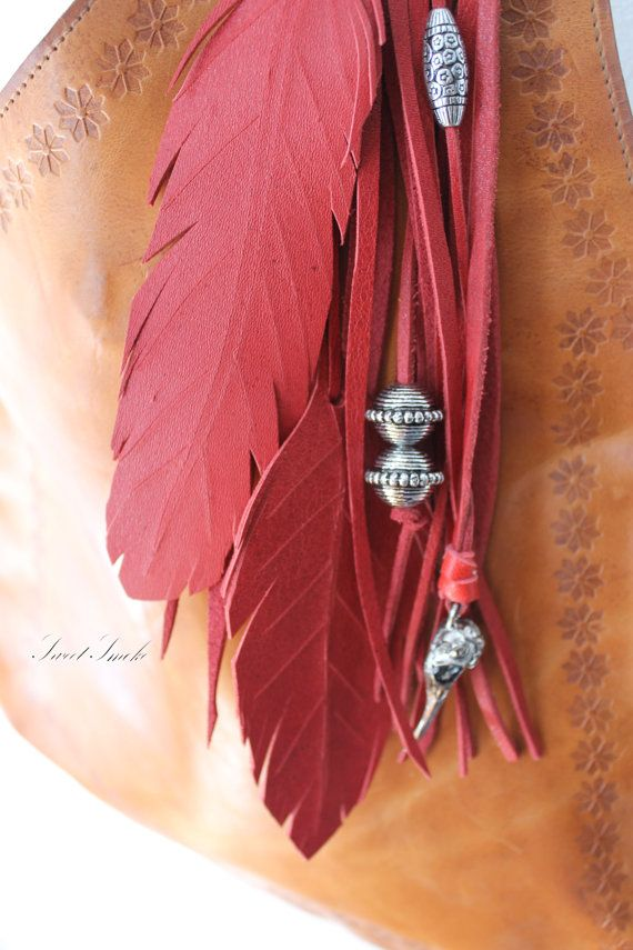 Deep red/burgundy leather bag charm.   Made of natural leather, silver color beads and little bird skull.  Measurements:  12 with the hanger, 9 charm  One of a kind