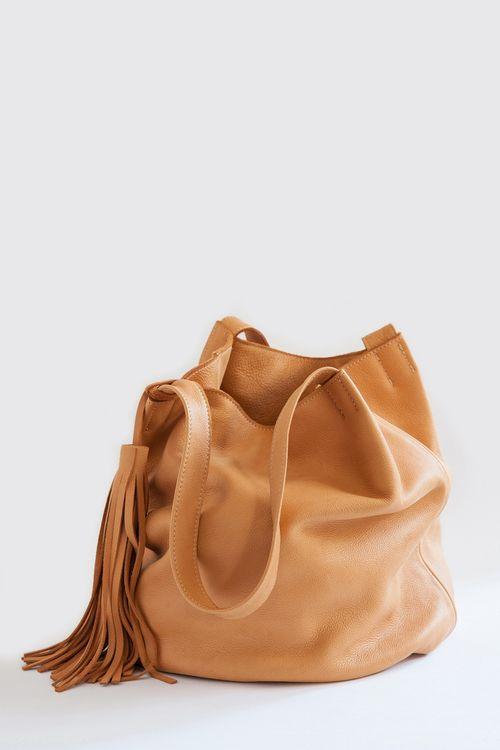 Slouchy bucket bag with tassel. | Source: northmagneticpole via classycs