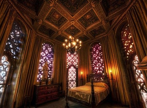What a beautiful bedroom....sooooo romantic with all that stained glass surrounding the bed.