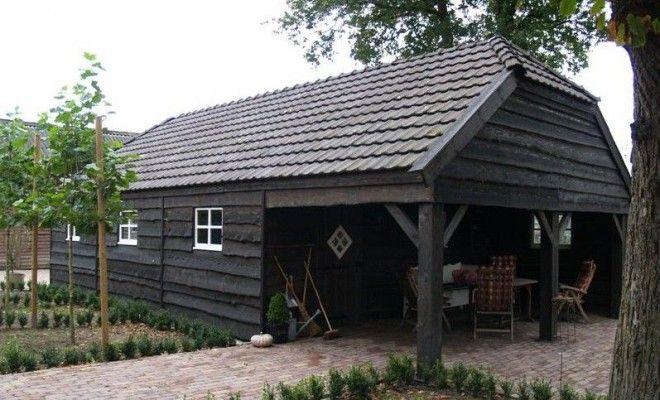 Super Deze tuinhuis met zwarte dakpannen is voorzien van een overkapping YK-61