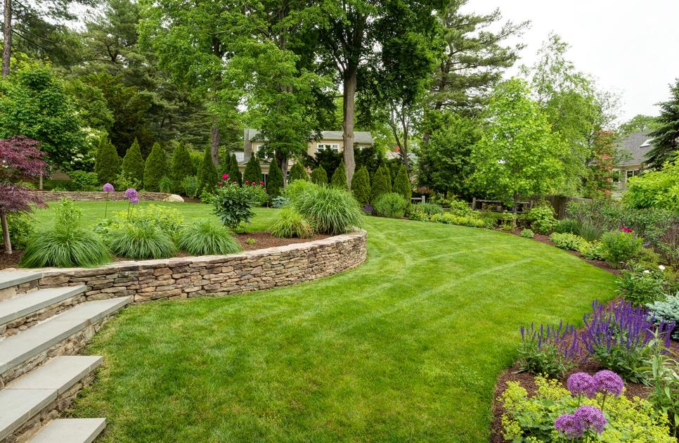 Lawns and Stone Retaining WallPhoto By: Rosemary FletcherFieldstone retaining walls help carve out separate areas for flat terraced lawns and a patio.