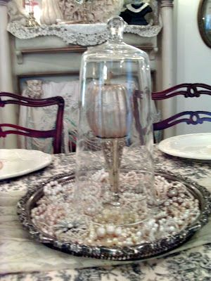 Penny's Vintage Home: Decorating with Cloches. Silver tray underneath with old pearly jewelry.