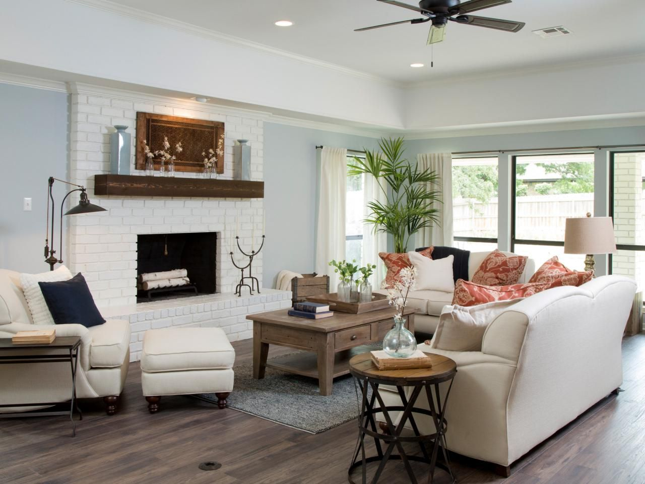 New Dark Wood Flooring Replaces The Worn Carpet Walls Are Painted In A Tranquil Blue And Ceiling Fireplace Bright White