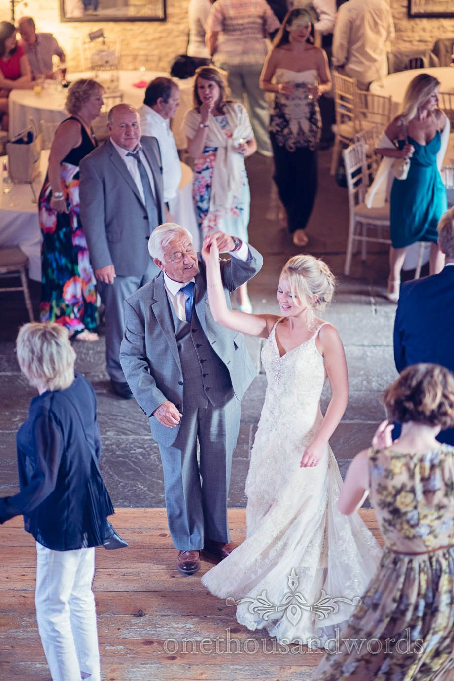 Bride and her grandfather dance from Kingston Country Courtyard Wedding Photographs. Photography by one thousand words wedding photographers