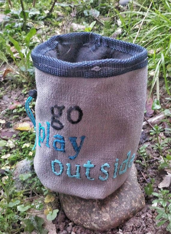 This one of a kind chalk bag was hand embroidered with the words go play outside. Felt lined with webbing around the edges for durability, this