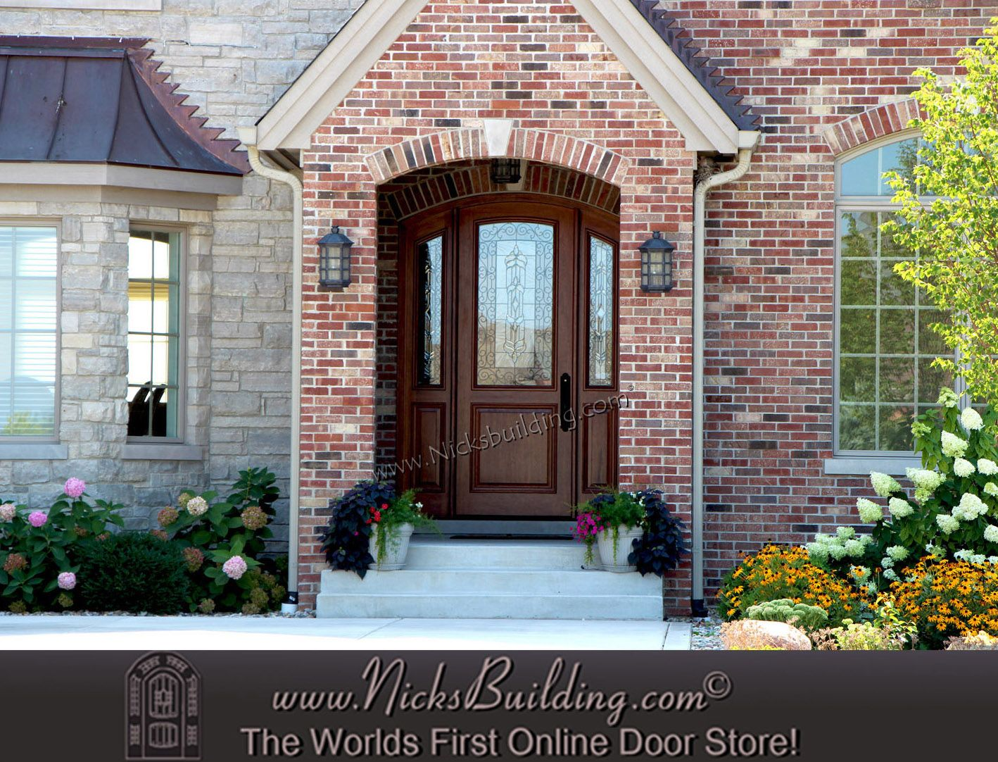 Red brick front entrance with arched door from - Brick house front door ...
