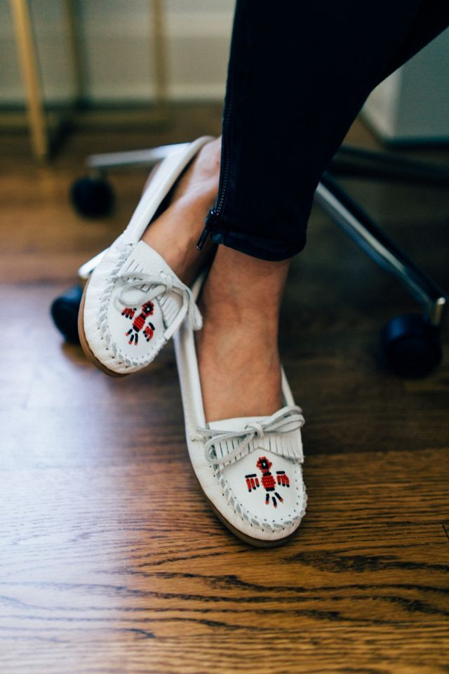 Sit pretty in the Minnetonka Thunderbird Moccasin in white. Available now  on SHOES.COM. cb809bf73d