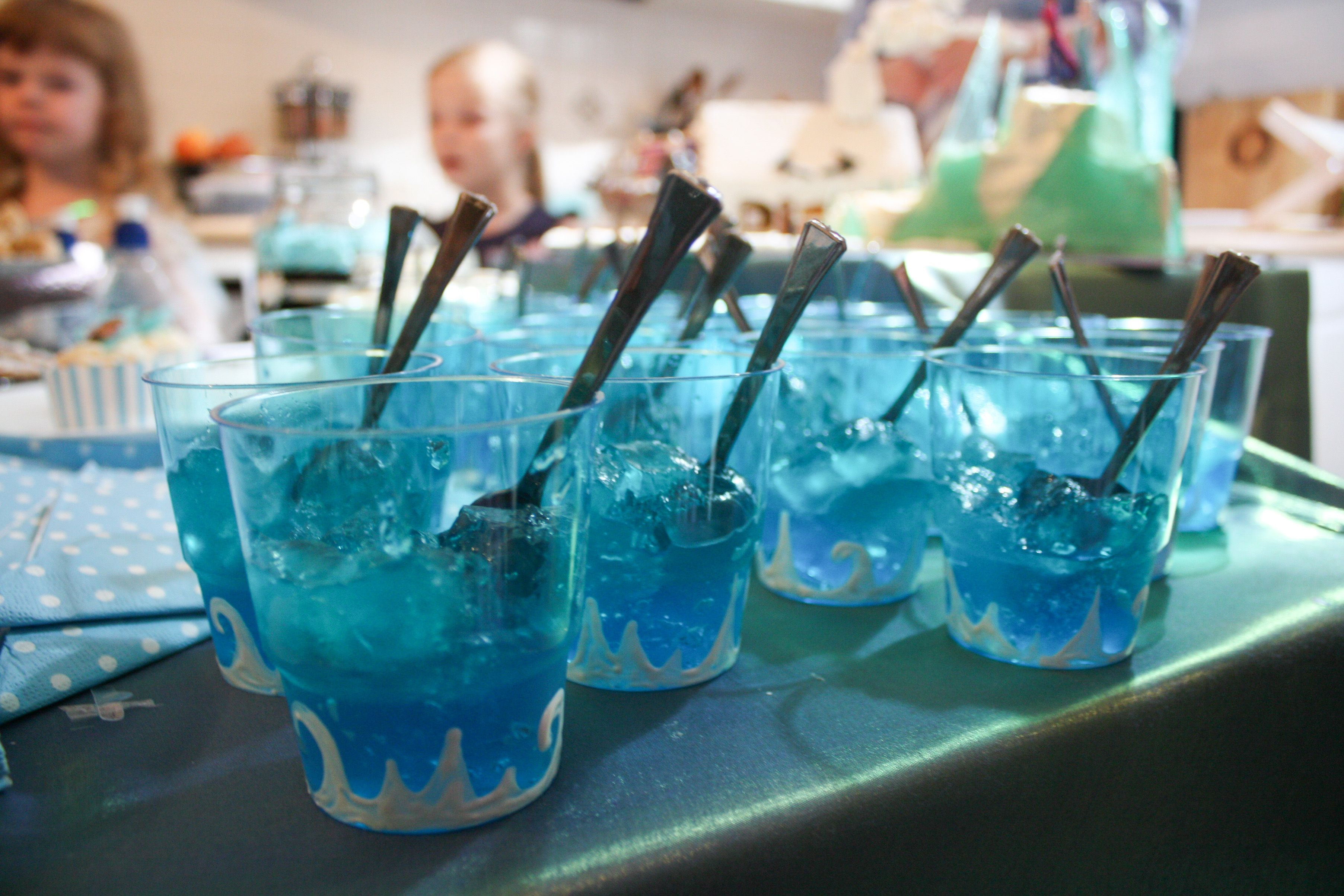 two tone blue jelly in hand decorated jelly cups i used metallic white puff paint from lindcraft to adorn the outside of t coco frozen frozen party jelly cups pinterest