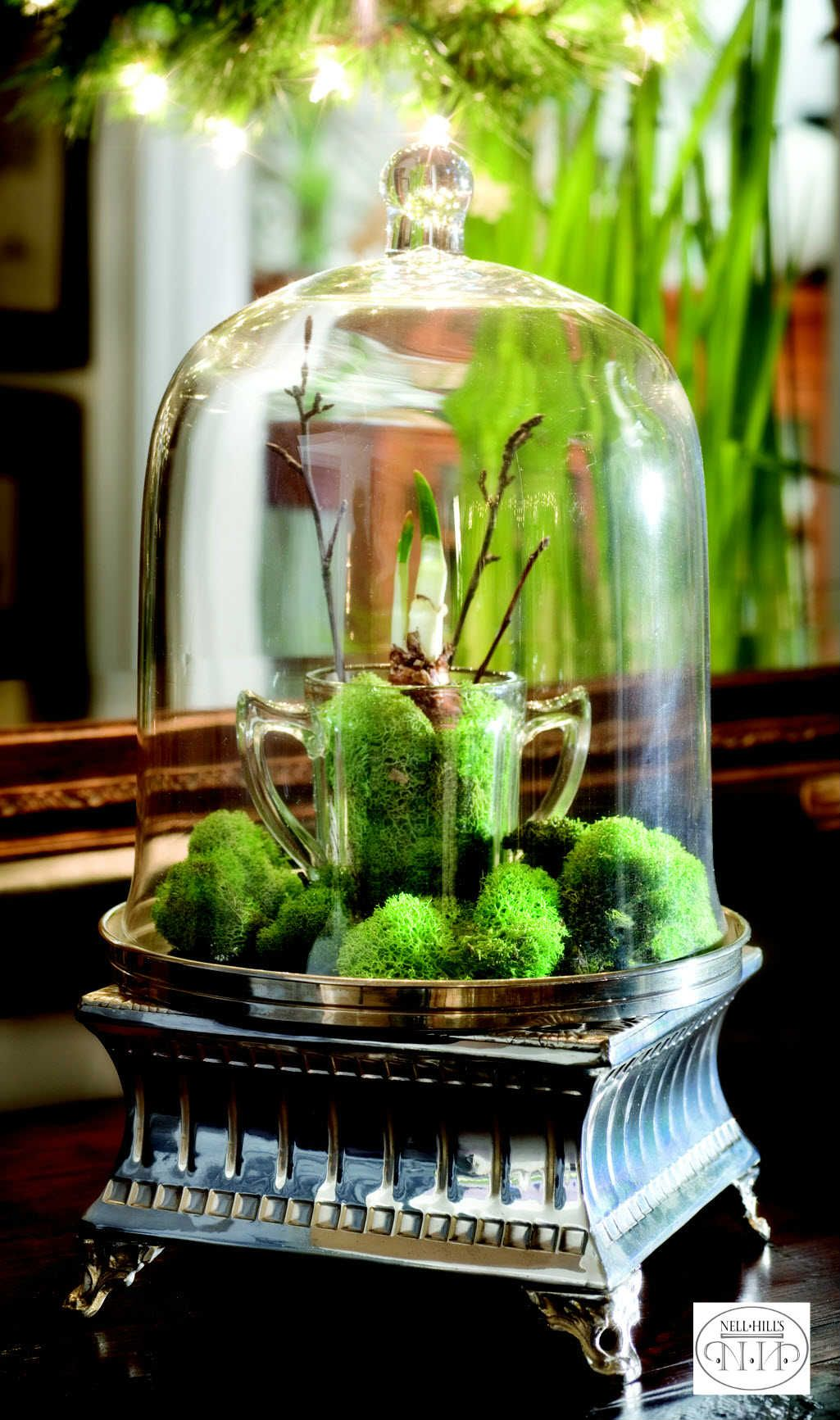 Use a riser and a cloche to make a magical holiday display.