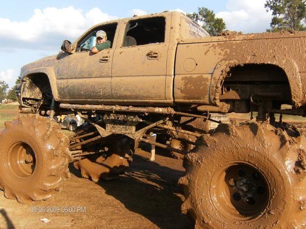 jacked up chevy trucks mudding - photo #10