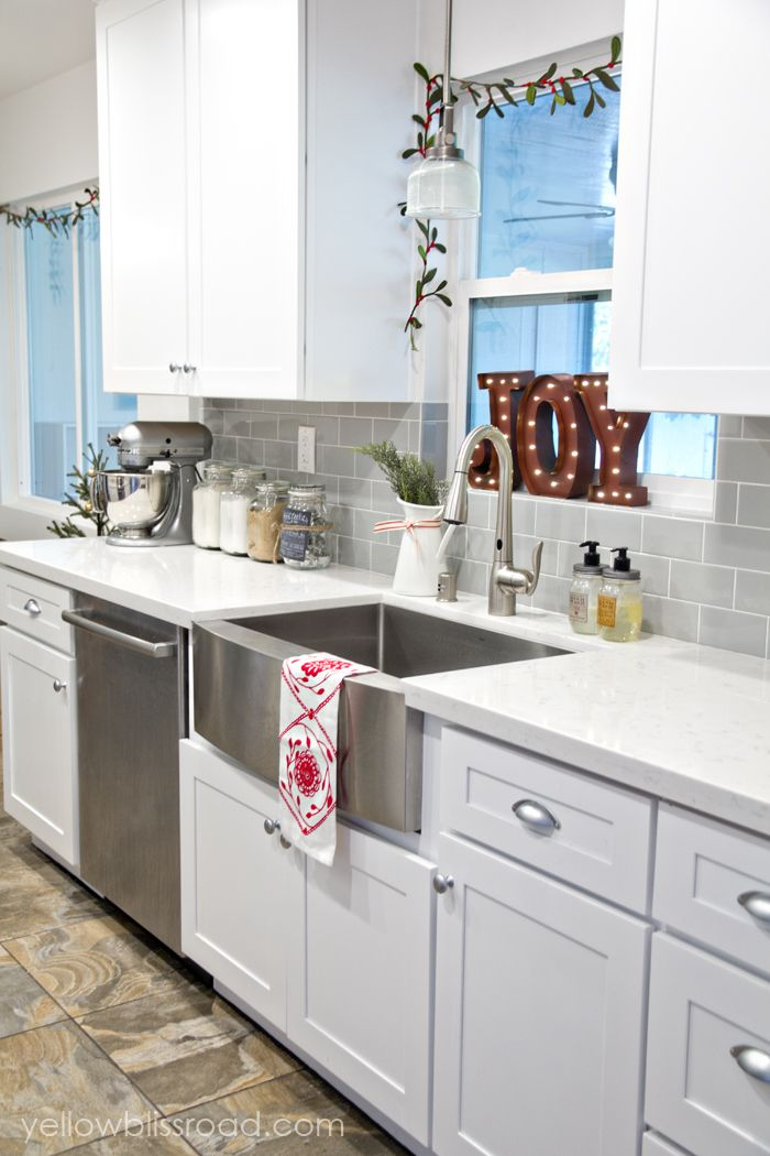 christmas decorating in the kitchen i love the gray backsplash tile so pretty