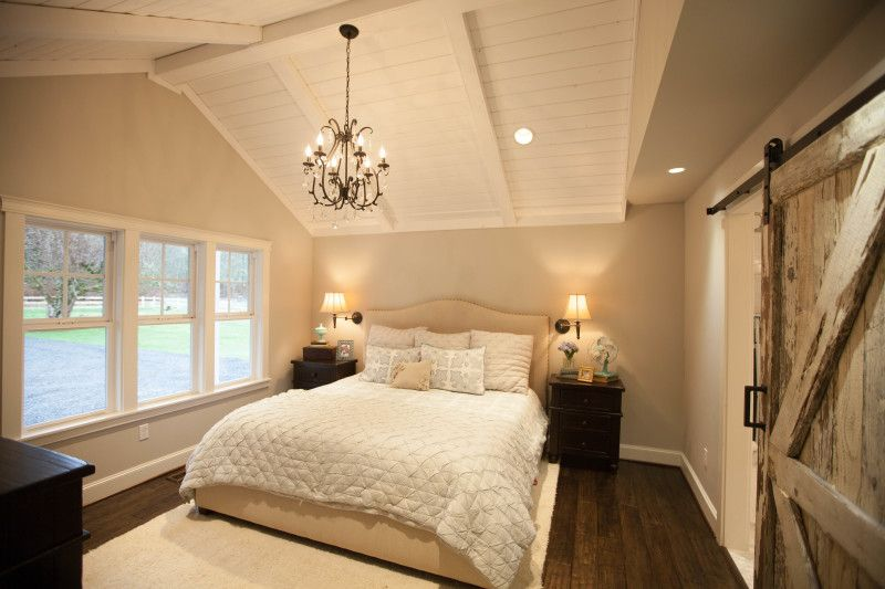 Keller farmhouse bedroom with vaulted ceiling barn door for Joanna gaines bedroom ideas