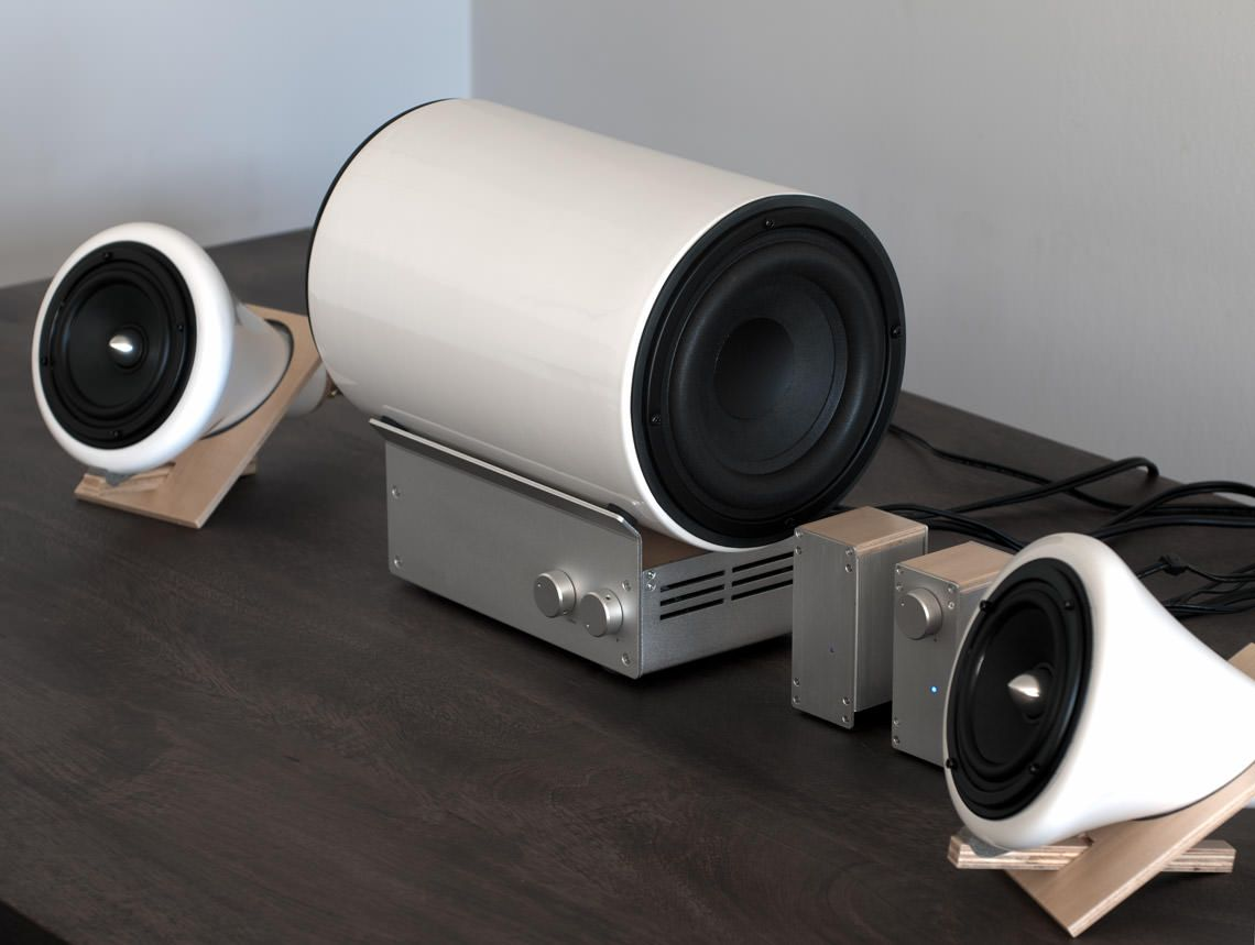 The ceramic speakers and subwoofer designed by joey roth a simple modern sound system for the for Best bluetooth speaker for living room