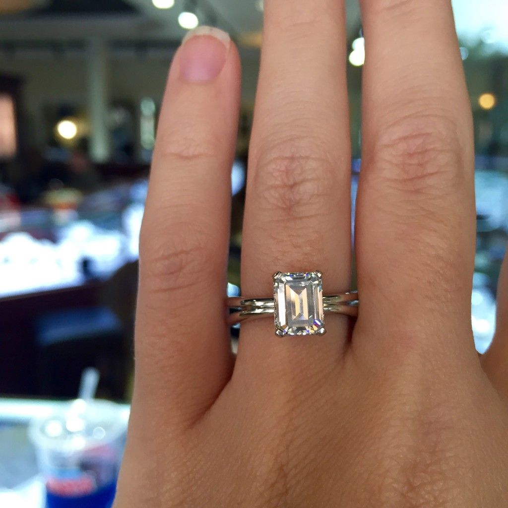 A Jaffe solitaire emerald cut engagement ring so unique