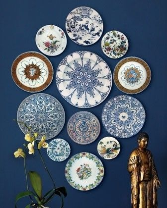 repurposed dinner plates hung on the walls are a funky idea for a