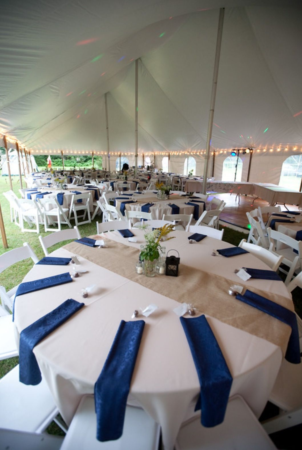 napkins for wedding Tent wedding Ivory tablecloths with burlap runners and navy blue napkins
