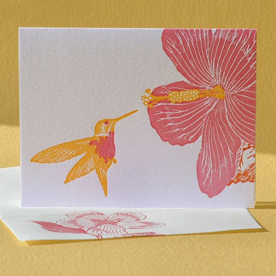 """The hummingbird and hibiscus show off their equally dazzling colors on a bright, warm day. Share this rare moment in the garden with a friend, loved one, or favorite backyard naturalist. Letterpress printed in dark pink and golden yellow inks on pearl white paper.    This card is also available with a """"Happy Birthday"""" or """"Congratulations"""" greeting. $5.00"""