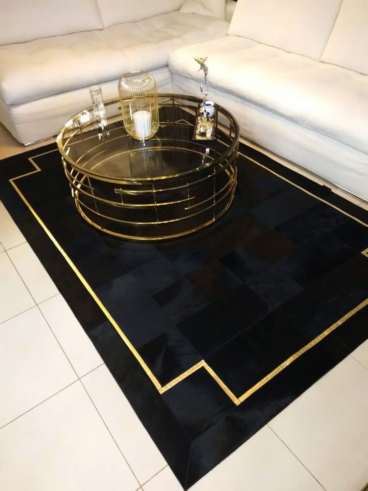 Deep Black Cowhide Panels Create A Formidable Rug That Cannot Be Ignored Accented With A Go Patchwork Cowhide Black And Gold Living Room Patchwork Cowhide Rug
