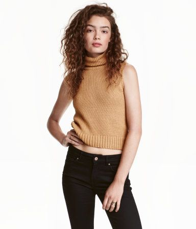 ade08424ee88e1 Sleeveless turtleneck sweater knit in a soft cotton blend with ribbing at  armholes and hem.