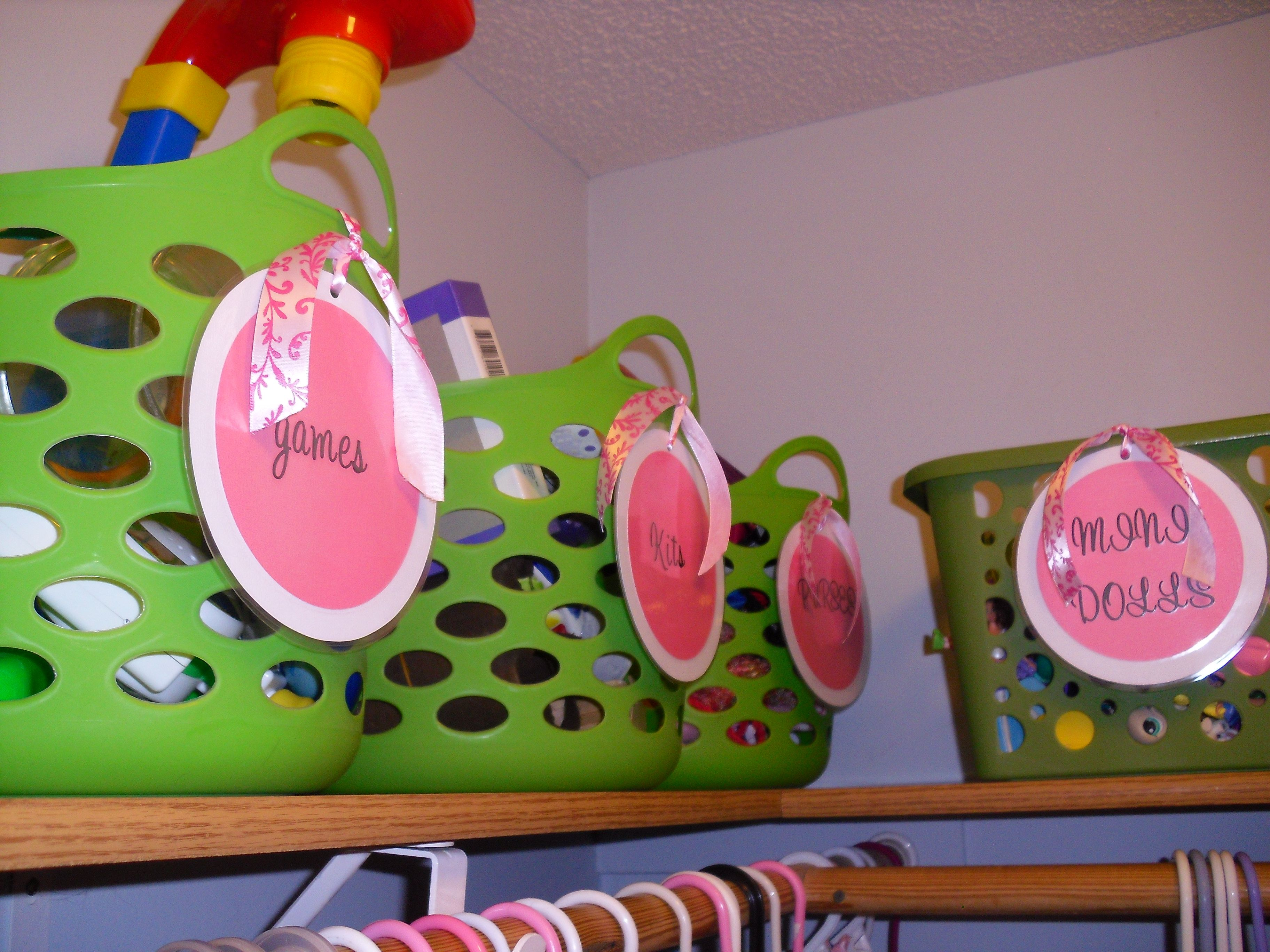 girl closet re do using baskets from dollar tree cardstock letters ribbon