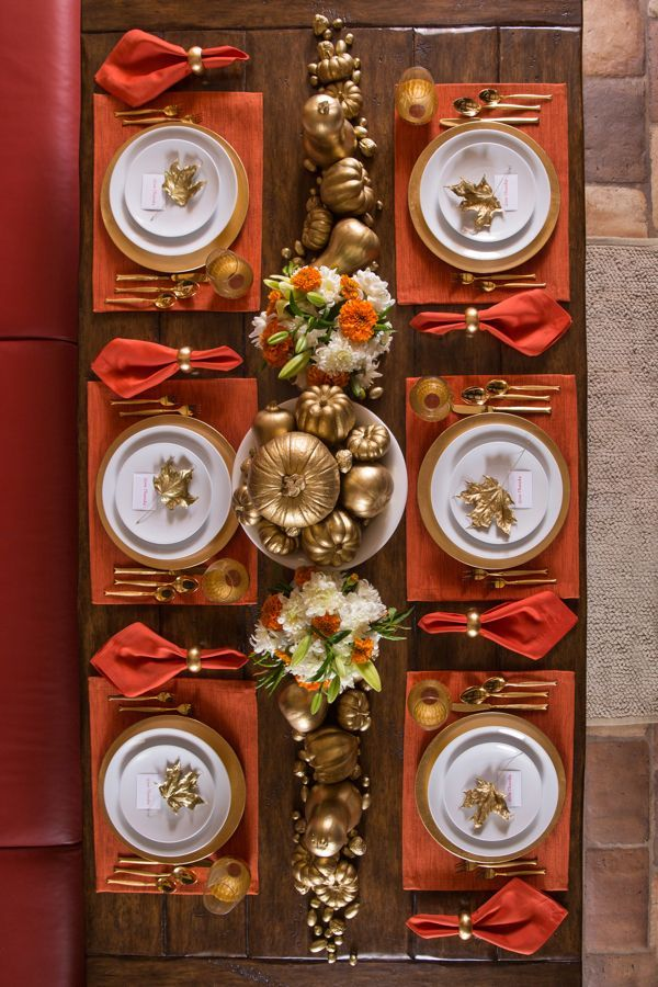 Gilded and Traditional Theme Thanksgiving Tablescape: Orange placemats and napki