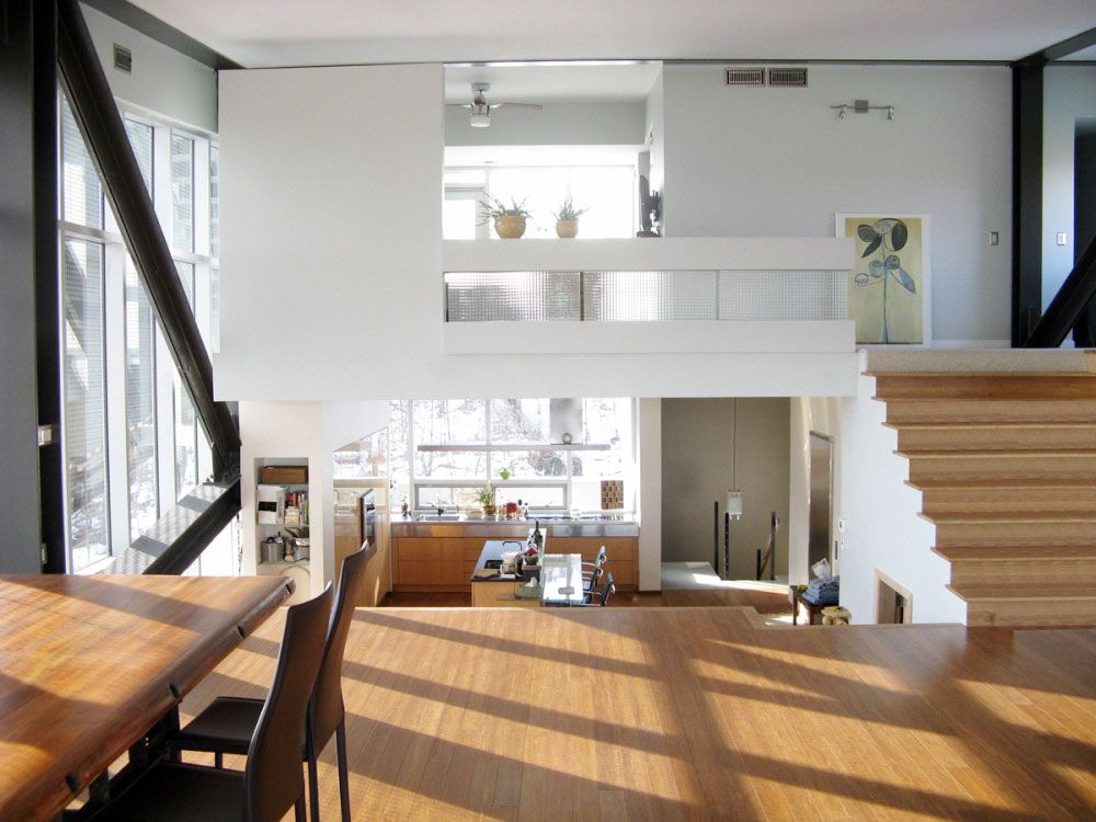 The Floating Shack House Design Open Kitchen   The Horizontal Steel  Structure Upstairs Contains Living Area