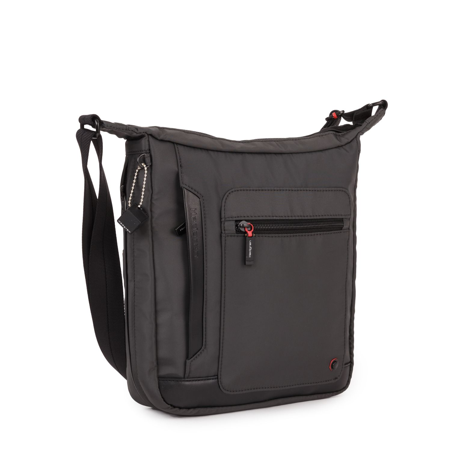 The external vertical crossover is a medium-sized bag which will fit your tablet. It has the ideal shape for daily use. not too big, yet still plenty of storage possibilities.