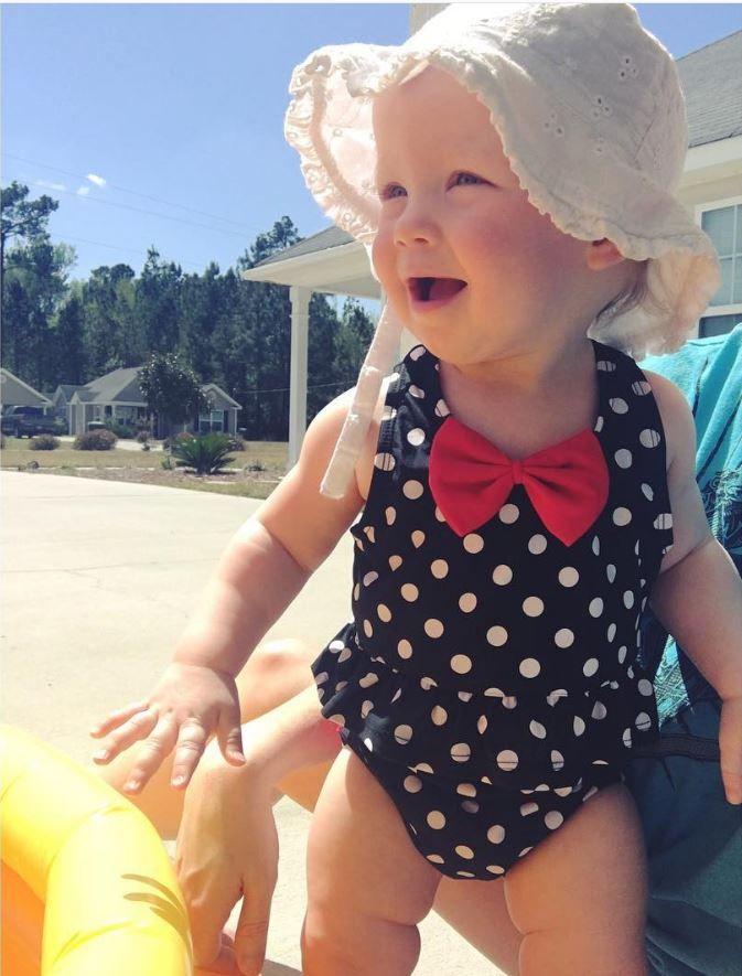 Your little girl will look like a vintage star in this adorable polka dot peplum bikini.