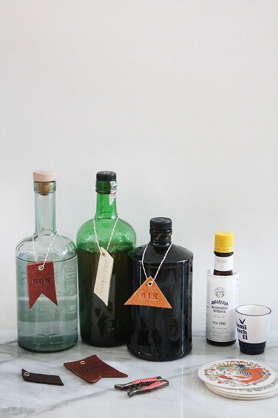 Dress up your home bar with DIY leather tags.