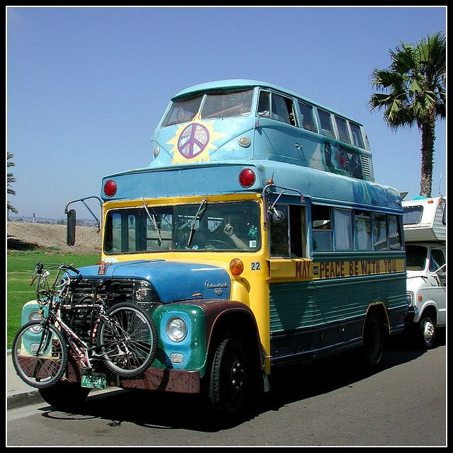 gotta love these hippie buses love the vw camper on the roof would you live the rv life or just go camping in this