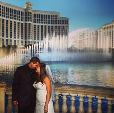 www.lasvegasweddingwagon.com Las Vegas Wedding Wagon Photo of the Day;  Another great pic from our archiving.  A lovely couple embracing each other on their wedding day in front of The Bellagio Fountains during one of their amazing daily routines.  Beautiful!   #lasvegasweddingwagon #weddingwagon #vegaswedding #lasvegaswedding #vegasbaby #lasvegas #wedding #weddingday #bride #bellagio