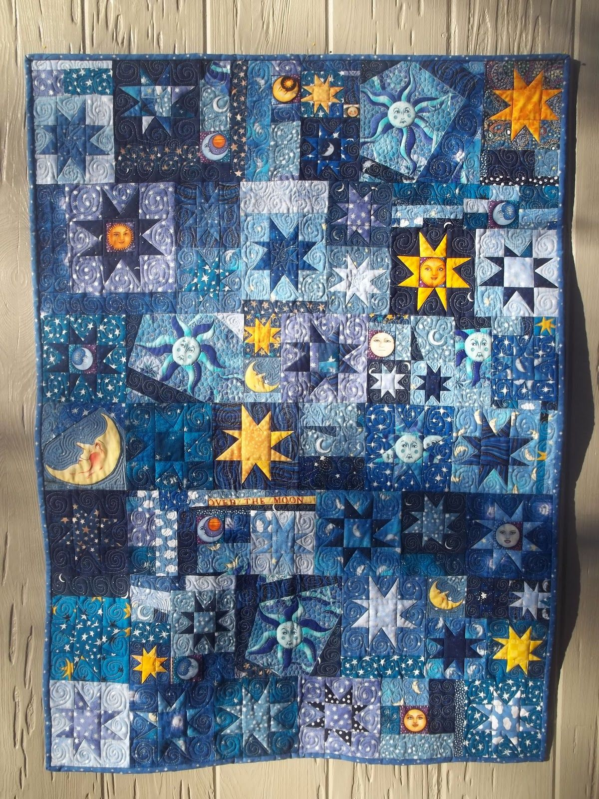 Kelly girl quilts stars and moon quilt finish sun moon for Celestial pattern fabric