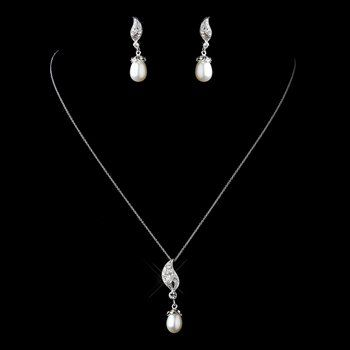 Solid Sterling Silver CZ Crystal & Diamond White Pearl Necklace & Earrings Set  This classic styled pearl bridal necklace and earring set is a wonderful choice for any classic or vintage inspired bride. It features a pendant of small encrusted rhinestones and an ivory faux pearl drop strung on a delicate Solid 925 silver chain with matching dangle pearl earrings with the same design.