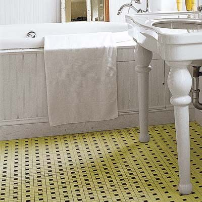 Refresh a vintage tiled floor such as this unglazed art deco era yellow and black porcelain mosaic with an eco and homeowner friendly acid etcher that