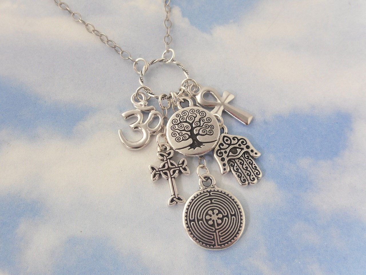 Ancient religions coexist silver charm cluster necklace om hamsa ancient religions coexist silver charm cluster necklace om hamsa hand tree of life aloadofball Gallery