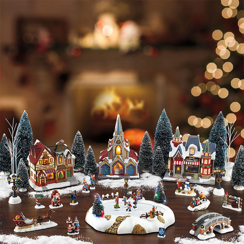 Piece table top christmas village scene with lights and