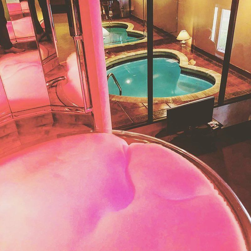 The 7 Champagne Tower Overlooks The Heart Shaped Tub At Cove Haven Resort Romantic Bathrooms Unusual Hotels Poconos