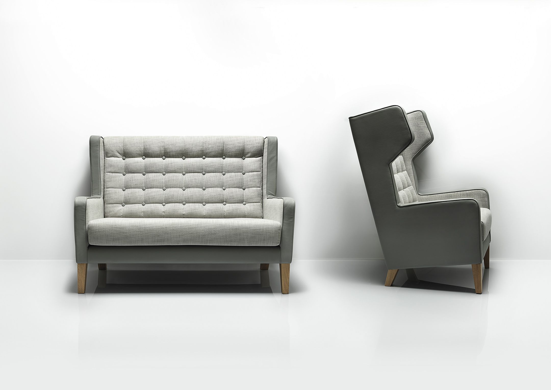 Grainger by Allermuir: Designed to invite private discussion and quiet contemplation, the Grainger collection encompasses a range of luxurious high and low back winged chairs, a two-seater sofa and complementary buttoned ottomans. Grainger's versatile style is a perfect accompaniment to both modern and vintage interiors, whilst the acoustic properties of the seat's wing panels make the piece ideal for breakout areas and executive lounges, or hotel and hospitality environments.
