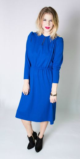 Nothing will get you down in this amazing blue vintage keyhole 60s dress.  With an elastic waist band, and thick layered pleats that run down the bodice, this dress is bold, classic, and essential to your everyday wardrobe.