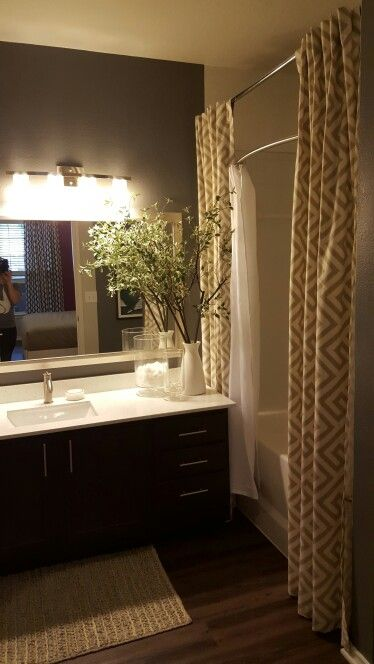 Add A Second Curtain Rod To Make Your Bathroom Feel Taller