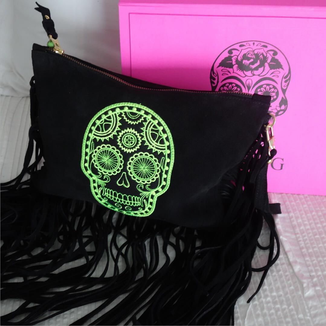 Green Skull Black Suede Fringe Clutch. #PetiteG #handbags
