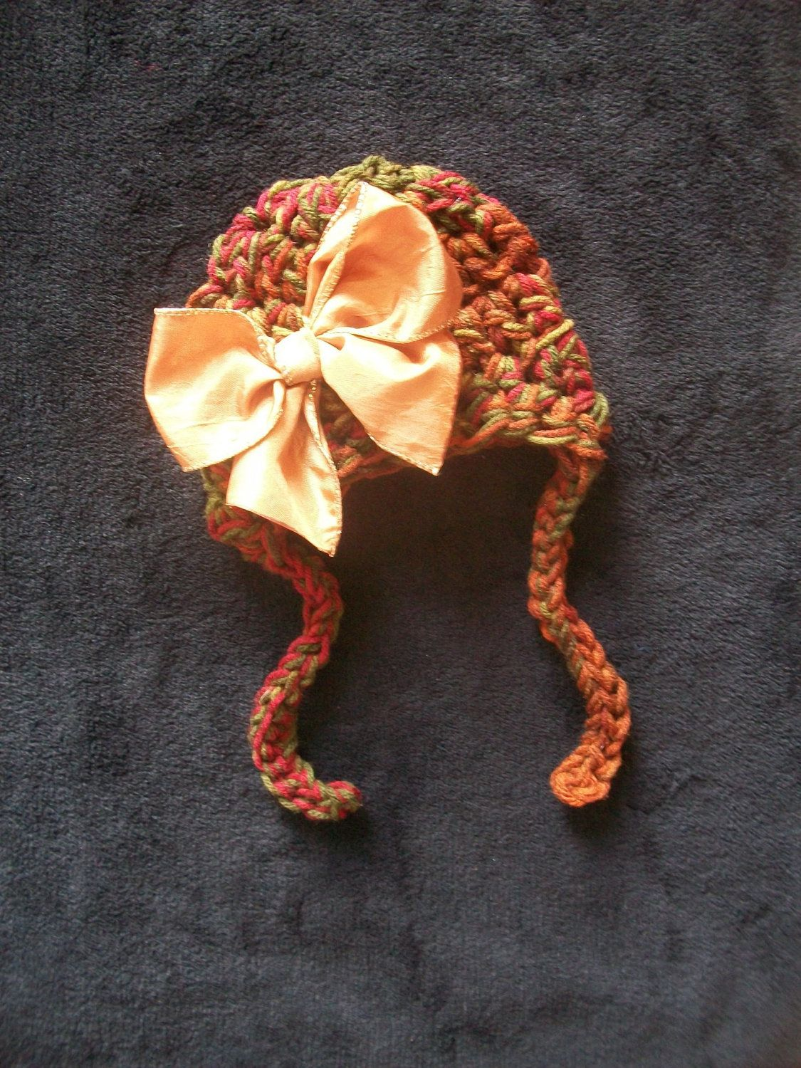 Fall Harvest Baby Hat with Earflaps, Ties, Large Golden Bow  -   Many Sizes - Preemie, Newborn, Infant. $15.00, via Etsy.
